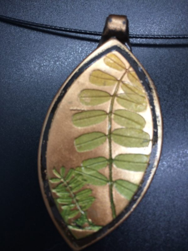 pendant with vetch leaf on polymer clay