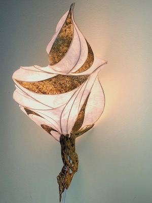 "Light sculpture ""Desert Flame"" with paper over reed, okra handmade paper accents, and cholla wood base"