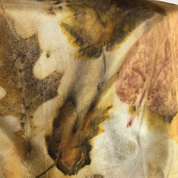 detail of leaf prints on eco printed silk scarf